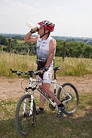 Cyclist on mountain bike with water bottle