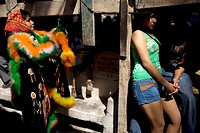 A young Chinelo dancer get dressed as a couple stands nearby during carnival celebrations in Yautepec, Mexico, February 28, 2009  Groups of Chinelos d...