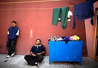 Undocumented Central American migrants traveling across Mexico to work in the United States sit in a shelter for migrants located along the railroad i...
