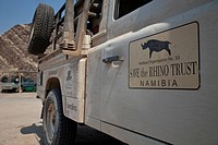 Namibia, Damaraland. Sign on vehicle owned by Save the Rhino Trust. Credit: Bill Young / Jaynes Gallery / DanitaDelimont.com