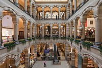 Arcades in the inner courtyard of Magna Plaza shopping centre in the former building of the Main Post Office, Nieuwezijds Voorburgwal, Amsterdam, Holl...