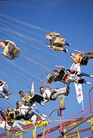 Germany, Munich. Visitors enjoying ride high above the crowd at Oktoberfest