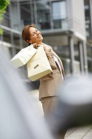 Smiling business woman, 45 years, carrying shopping bags