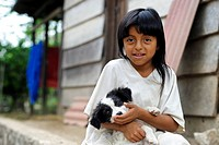 Child of the Lacandon Maya with a dog in the rainforest of Chiapas, last descendants of the Maya, Mexico, North America
