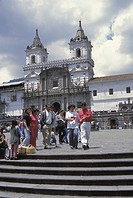 Ecuador, Quito. Natives in front of San Francisco Church, built in 1553, and was the first church erected by Spaniards in South America. Credit: Don G...