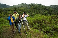 Ecuador. Tourists and guides birdwatching in Maquipucuna Biological Reserve, 4500+ hectares purchased by The Nature Conservancy. MR