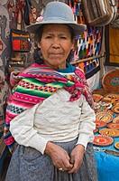 Peru, Pisac, Portrait of woman in market. Credit: Dennis Kirkland / Jaynes Gallery / DanitaDelimont.com