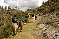 Tourists horseback riding to Temple of the Moon, Cuzco, Peru.