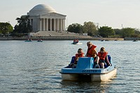 Mother, boy age 8 and girl age 6 on paddleboat in lake near Jefferson Memorial, Washington D.C. District of Columbia, United States. MR