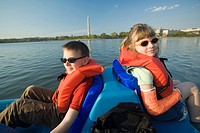 Boy age 8 and girl age 6 on paddleboat in lake near Washington Monument, Washington D.C. District of Columbia, United States. MR