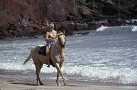 USA, Hawaii, Maui, Woman riding horse on Koki Beach MR