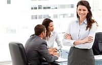 Happy businesswoman with her team during a meeting at the office