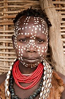 Karo girl with necklaces made of Cowry shells and facial paintings, Omo river valley, Southern Ethiopia