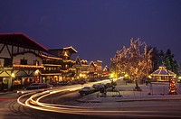 USA, Washington, Leavenworth. Christmas lights glow on Front Street and park during annual Christmas festival