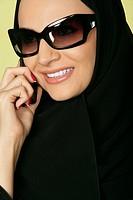 Arab lady on the phone.