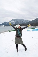 Young woman on the lakeshore of Walchensee or Lake Walchen, winter, freedom, Bavaria, Germany, Europe