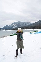 Young woman on the lakeshore of Walchensee or Lake Walchen, winter, coldness, Bavaria, Germany, Europe