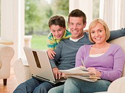 Family sitting together with laptop