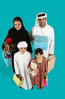 Arab Family holding a gift and shopping bag