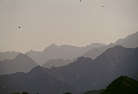 Silhouette of uneven mountains seen during the day.