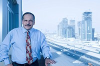 Portrait of a executive with the building constructions in the background in Dubai