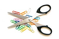 Scissors and multicolored paper clips