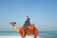 Businessman sitting on camel