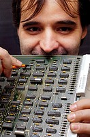 Technician holding a circuit board