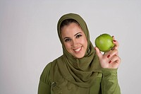 Young woman holding apple,portrait