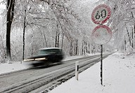 Speed limit of 60 on a snow-covered highway in winter with fast traffic, Hesse, Germany, Europe