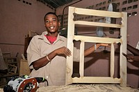 Young man in a training course for carpentry for young people from the Cite Soleil slums, Salesian project Lakay or The House, La Saline district, Por...