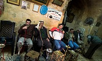 Arab men smoking traditional Nargilas inside an old tea house in the old city of Jerusalem