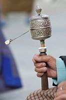 Buddhist pilgrim holding a prayer wheel, Thimpu, Bhutan, Asia