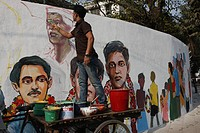A student paints on the wall near ´Central Shaheed Minar´ as part of preparations in observance of International Mother Language Day at the Central Sh...