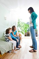 mother having serious talk with children