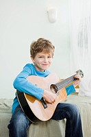 boy playing on guitar