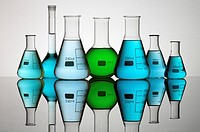 group of laboratory flasks containing liquid color