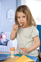 Girl having a meal.