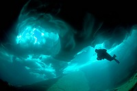 Ice Diving in Suisse Mountain Lake, Ticino, Switzerland