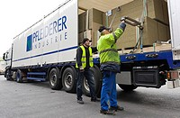 Employees securing particle boards loaded on a truck, Pfleiderer AG factory at the headquarters in Neumarkt, Upper Palatinate, Bavaria, Germany, Europ...