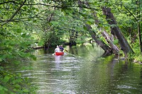 Father, children and grandfather canoeing on the Wuerm River in southern Bavaria, Upper Bavaria, Germany