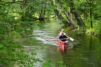 Two men canoeing on Wuerm River in southern Bavaria, Upper Bavaria, Germany