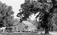 Black and white photo of a rural house in Arkansas
