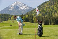 Golfer putting, alpine golf course, Achenkirch, Tyrol, Austria, Europe