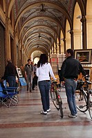 Shop lined arcade and Sunday art market in Bologna, Emilia-Romagna, Italy