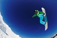 Snowboarder under blue sky, Funpark, Reit im Winkl, Chiemgau, Upper Bavaria, Bavaria, Germany, Europe