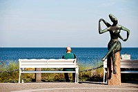 Man sitting on a bank while looking at view, Timmendorfer Strand, Schleswig_Holstein, Germany