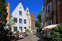 People at street cafe and historical houses at Schnoor quarter, Hanseatic City of Bremen, Germany, Europe