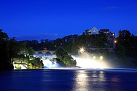 The illuminated Rhine Falls near Schaffhausen in the evening, Laufen castle, High Rhine, Canton Schaffhausen, Switzerland, Europe
