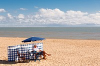 A man relaxing on the beach in Southwold , Suffolk , England , Britain , Uk